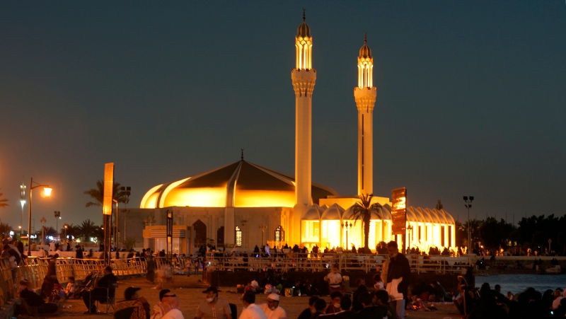 People sit at a park outside Hasan Anani mosque, in Jiddah, Saudi Arabia, Friday, Jan. 15, 2021. (AP Photo/Amr Nabil)