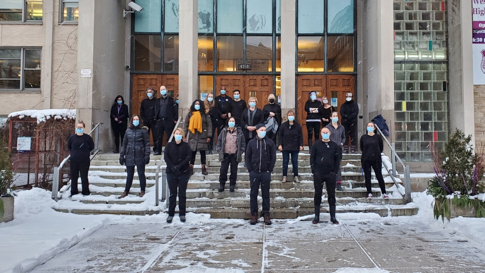 "Teachers at Westmount High School are wearing all black to, among other things, ""mourn the inevitable deaths that will occur due to the increased transmission caused by school reopenings"" in Montreal on Monday, Jan. 18, 2021. (Jean-Luc Boulch, CTV News Montreal)"
