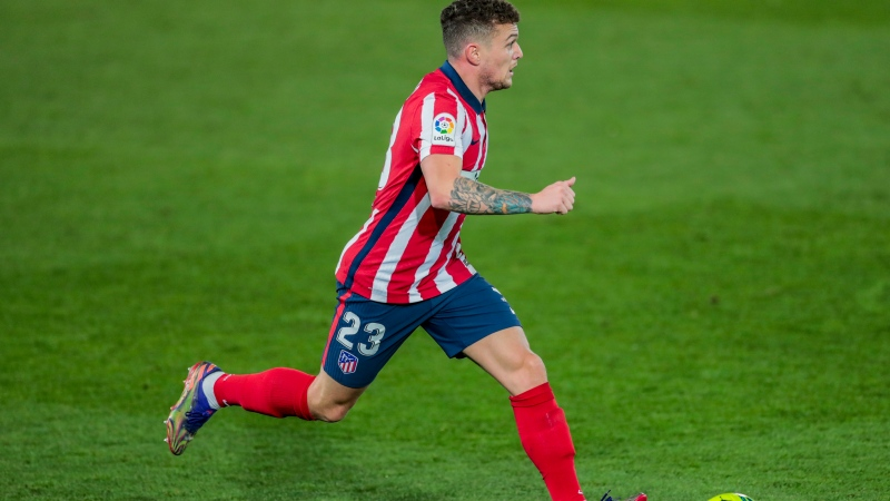 In this Saturday, Dec. 12, 2020 file photo, Atletico Madrid's Kieran Trippier runs with the ball during the Spanish La Liga soccer match between Real Madrid and Atletico Madrid at the Alfredo Di Stefano stadium in Madrid, Spain. England and Atletico Madrid defender Kieran Trippier has been banned from football for 10 weeks and fined $94,000 for breaching betting rules in a punishment from The English Football Association that applies worldwide. The misconduct denied by Trippier happened in July 2019 — the month he left Tottenham for Atletico. The FA said an independent regulatory commission proved four of the breaches but dismissed three allegations during a personal hearing. (AP Photo/Bernat Armangue, File)