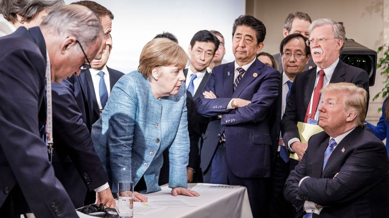 In this photo provided by the German Government Press Office (BPA), German Chancellor Angela Merkel deliberates with U.S. president Donald Trump on the sidelines of the official agenda on the second day of the G7 summit on June 9, 2018 in Charlevoix, Canada. (Photo by Jesco Denzel /Bundesregierung via Getty Images)