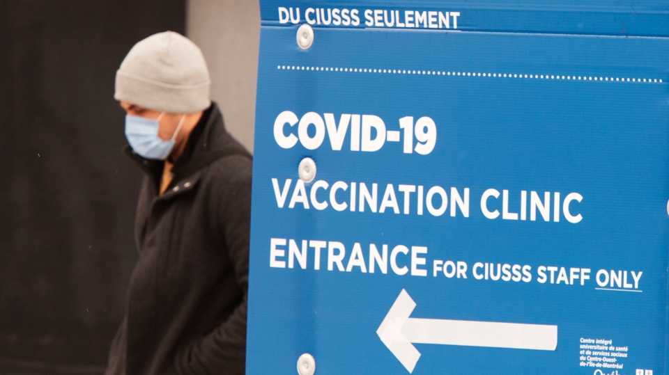 A man walks past the COVID-19 vaccination site at Maimonides long term care facility Wednesday, January 13, 2021 in Montreal. THE CANADIAN PRESS/Ryan Remiorz
