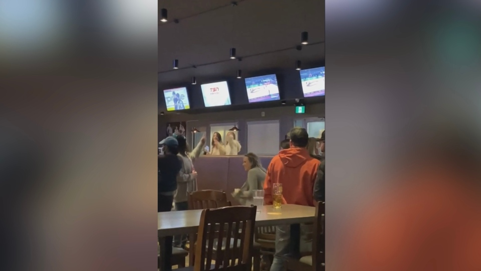 A video shows several people at The Tap in Regina, without masks on, dancing and shouting and failing to remain physically distant. (Lynnai Irving-Hicks / Facebook)