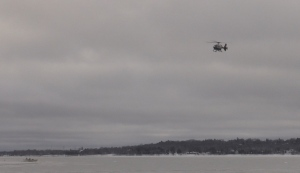 The OPP helicopter assists in Midland, Ont., on Mon., Jan. 18, 2021, as the search for two snowmobilers continues. (Roger Klein/CTV News)