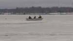 Crews search for two missing snowmobilers in Midland, Ont., on Mon., Jan. 18, 2021. (Roger Klein/CTV News)