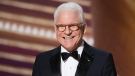 """Actor Steve Martin speaks on stage during the Oscars in 2020 in Hollywood. Martin has """"good news/bad news"""" about getting the COVID-19 vaccination."""