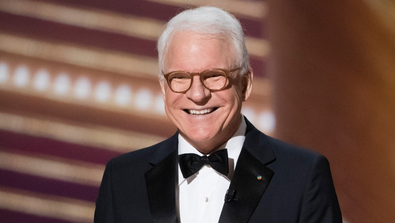 "Actor Steve Martin speaks on stage during the Oscars in 2020 in Hollywood. Martin has ""good news/bad news"" about getting the COVID-19 vaccination."