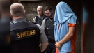 Jimmy Melvin Jr. is escorted from Nova Scotia provincial court in Halifax on Monday, July 20, 2015. Melvin faces first-degree murder charges related to the 2009 shooting death of Terry Marriott Jr. THE CANADIAN PRESS/Andrew Vaughan