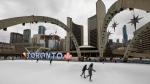 People go for a New Years Day skate at Nathan Phillips Square in Toronto, Friday, Jan. 1, 2021 (Cole Burston/The Canadian Press)