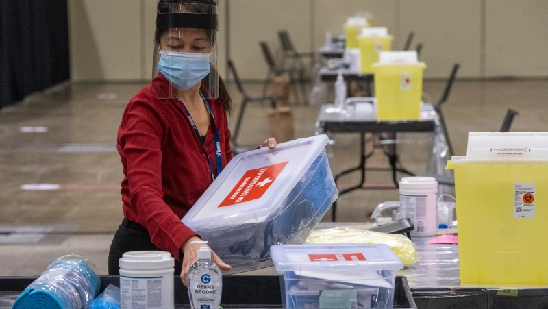 Toronto Public Health nurse Lalaine Agarin makes preparations at Toronto's Mass Vaccination Clinic on Sunday January 17, 2021. THE CANADIAN PRESS/Frank Gunn