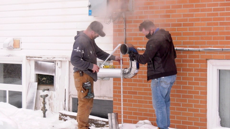 Brad Williamson and Craig Poggemiller made repairs to an apartment building on Bateman Crescent, following a dangerous carbon monoxide leak. (Chad Hills/CTV News)