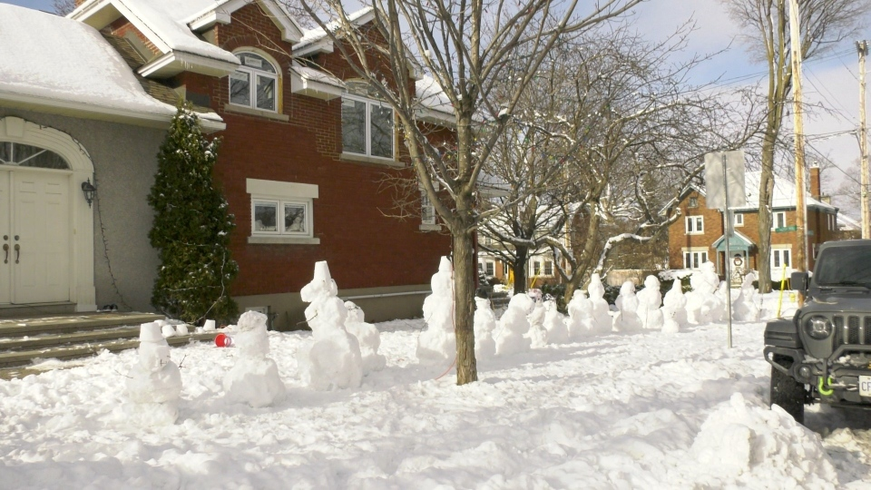 More than a dozen snowmen outside the McComb's house. (Dave Charbonneau / CTV News Ottawa)