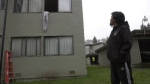 Andrew Dawson looks up at his apartment window that he and family members were forced to jump out of after a fire broke out in the building: (CTV News)