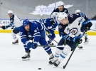 Toronto Maple Leafs centre Joe Thornton (97) battles for the puck against Winnipeg Jets defenceman Neal Pionk (4) during first period NHL hockey action in Toronto on Monday, January 18, 2021. THE CANADIAN PRESS/Nathan Denette