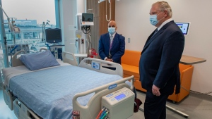Ontario Premier Doug Ford is given a tour of a digital Intensive Care Unit room at Cortellucci Vaughan Hospital by Altaf Stationwala, President and CEO of Mackenzie Health in Vaughan, Ontario on Monday, January 18, 2021. THE CANADIAN PRESS/Frank Gunn