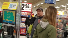 A man without a mask is seen during a verbal disagreement over the COVID-19 vaccine in a Superstore in Langley, B.C.