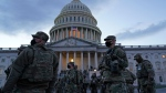 National Guard troops gather on the East front of the U.S. Capitol in Washington, Monday, Jan. 18, 2021, ahead of the 59th Presidential Inauguration. (AP / Susan Walsh)