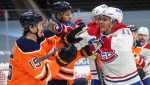 Edmonton Oilers' Josh Archibald (15) and Montreal Canadiens' Brendan Gallagher (11) rough it up during third period NHL action in Edmonton on Monday, January 18, 2021. THE CANADIAN PRESS/Jason Franson