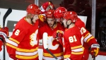 Calgary Flames' Johnny Gaudreau, centre, celebrates his goal with teammates during second period NHL hockey action against the Vancouver Canucks in Calgary, Monday, Jan. 18, 2021.THE CANADIAN PRESS/Jeff McIntosh