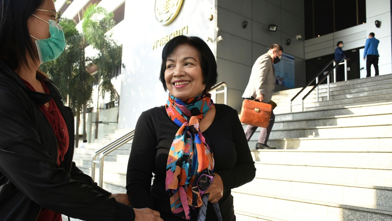 A woman identified only by her first name Anchan, right, talks to her friend as she arrives at the Bangkok Criminal Court in Bangkok, Thailand, Tuesday, Jan. 19, 2021. (AP Photo)