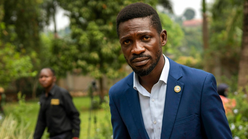 FILE- in this Jan. 15, 2021 file photo, Uganda's leading opposition challenger Bobi Wine walks back to his residence after giving a press conference outside Kampala, Uganda. (AP Photo/Jerome Delay, File)
