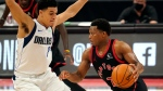 Toronto Raptors guard Kyle Lowry (7) drives against Dallas Mavericks guard Josh Green (8) during the second half of an NBA basketball game Monday, Jan. 18, 2021, in Tampa, Fla. (AP Photo/Chris O'Meara)