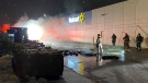 Fire crews on the scene of a fire behind a Cambridge Walmart on Jan. 18, 2021. (Terry Kelly / CTV Kitchener)