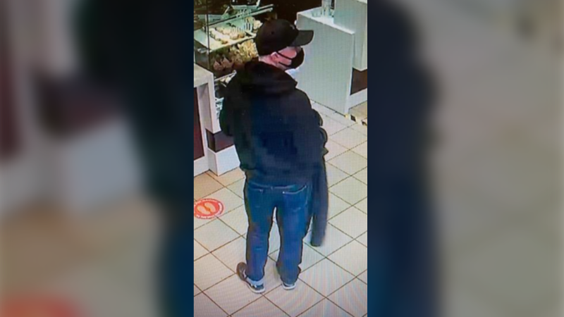 On Jan. 15, video surveillance shows the man wearing a black non-medical mask, black hat, black jacket and black shoes with white soles. (Photo courtesy: Kings District RCMP)