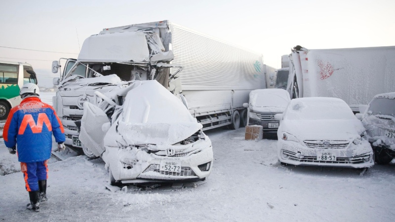 Damaged cars are covered with snow after a multiple accident on the Tohoku Expressway in Osaki city, Japan, on Jan. 19. 2021. (Yusuke Ogata / Kyodo News via AP)