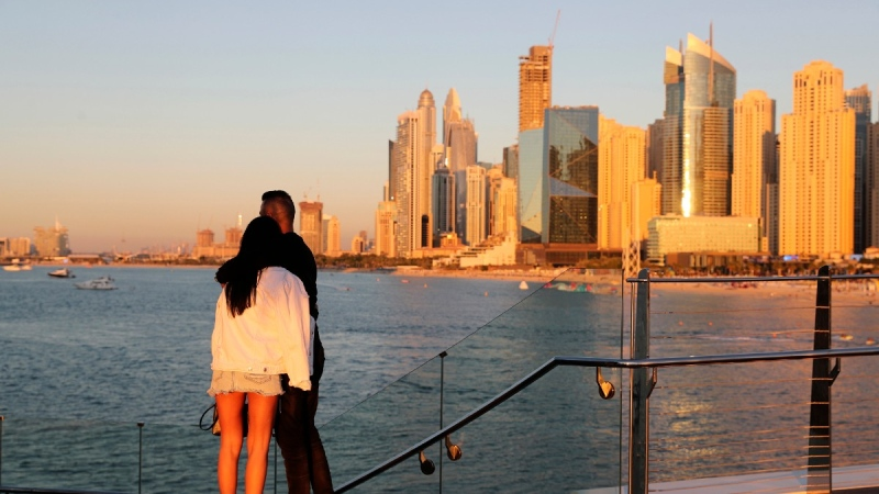 Tourists look at the skyline at sunset, in Dubai, United Arab Emirates, on Jan. 12, 2021. (Kamran Jebreili / AP)