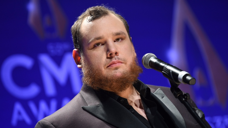 Singer-songwriter Luke Combs speaks in the press room after winning awards for male vocalist of the year and song of the year at the 53rd annual CMA Awards at Bridgestone Arena, in this Wednesday, Nov. 13, 2019, file photo. NASCAR will attempt some normalcy at the season-opening Daytona 500 with a live pre-race concert featuring country music star Luke Combs. (Photo by Evan Agostini/Invision/AP, File)