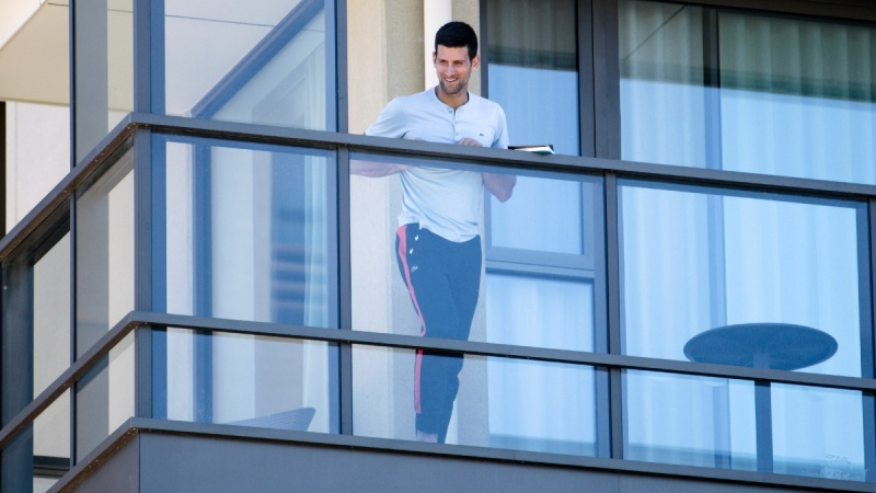 Novak Djokovic stands on the balcony at his accommodation in Adelaide, Australia, on Jan. 19, 2021. (Morgan Sette/AAP Image via AP)