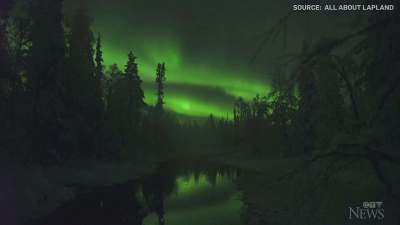 A photographer captured a stunning display of the northern lights over a snowy forest in the Finnish region on Lapland.