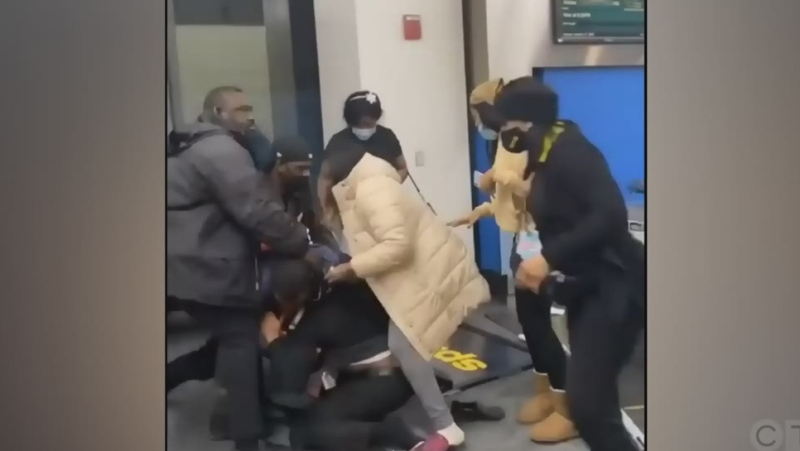 Caught on cam: Bag brawl at Detroit airport