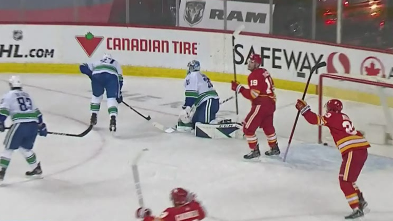 Flames beat Canucks