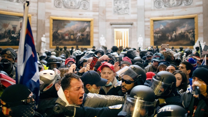 Police clash with supporters of U.S. President Donald Trump who breached security and entered the Capitol building in Washington D.C., United States on January 06, 2021. Pro-Trump rioters stormed the US Capitol as lawmakers were set to sign off Wednesday on President-elect Joe Biden's electoral victory in what was supposed to be a routine process headed to Inauguration Day. (Photo by Mostafa Bassim/Anadolu Agency via Getty Images)