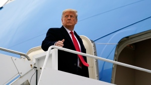 In this Tuesday, Jan. 12, 2021 file photo, U.S. President Donald Trump gestures as he boards Air Force One upon arrival at Valley International Airport, in Harlingen, Texas. (AP Photo/Alex Brandon, File)