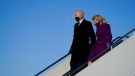 U.S. President-elect Joe Biden and his wife Jill Biden arrive at Andrews Air Force Base, Tuesday, Jan. 19, 2021, in Andrews Air Force Base, Md. (AP Photo/Evan Vucci)