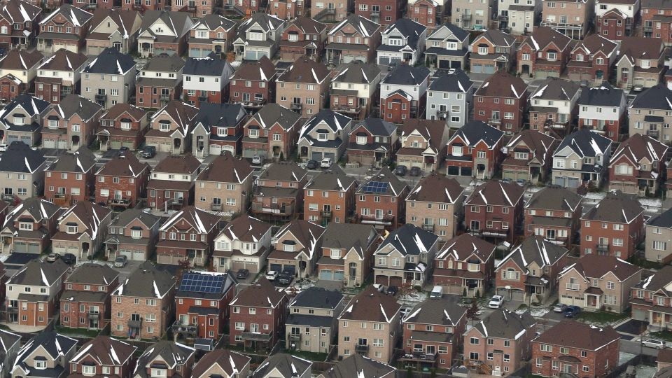 Aerial view of houses in Oshawa, Ont., seen from a Canadian forces Hercules on Saturday, Nov. 11, 2017. THE CANADIAN PRESS/Lars Hagberg