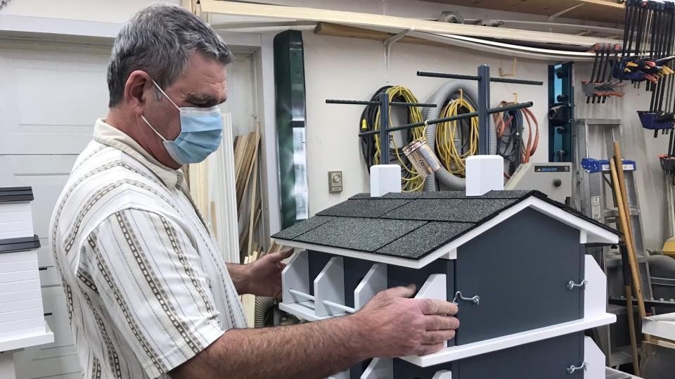 Dan Fradette with a custom birdhouse
