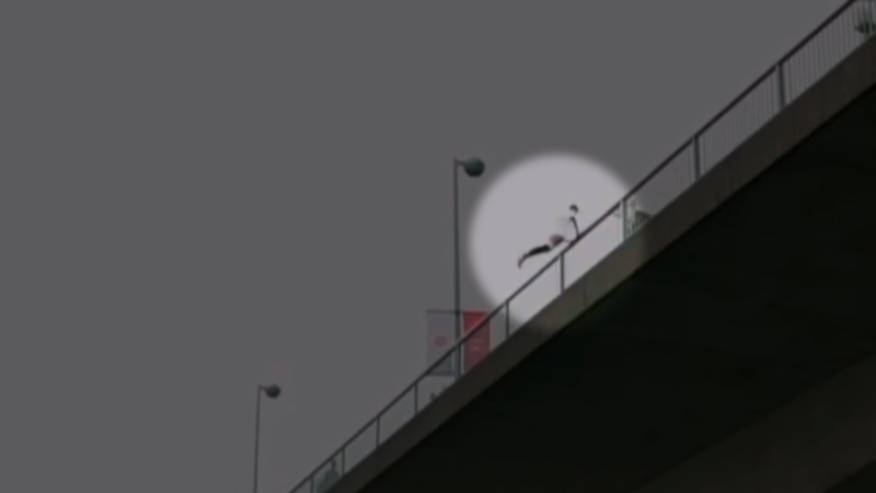 A man prepares to jump off the Cambie Bridge in Vancouver, B.C. for a stunt that was recently posted online.