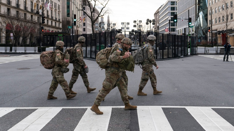 U.S. Army National Guard soldiers walk along K Street near Black Lives Matter Plaza, Tuesday, Jan. 19, 2021, in Washington. (AP / Alex Brandon)