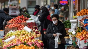 People wearing face masks to curb the spread of COVID-19 shop for produce at a market in North Vancouver, B.C., on Wednesday, January 6, 2020. THE CANADIAN PRESS/Darryl Dyck