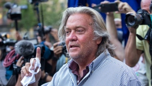 In this Aug. 20, 2020, file photo, President Donald Trump's former chief strategist, Steve Bannon, speaks with reporters in New York after pleading not guilty to charges that he ripped off donors to an online fundraising scheme to build a southern border wall. (AP Photo/Eduardo Munoz Alvarez, File)