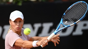 Yulia Putintseva returns the ball to Simona Halep during their quarterfinal match at the Italian Open tennis tournament, in Rome, Saturday, Sept. 19, 2020. (Alfredo Falcone/LaPresse via AP)