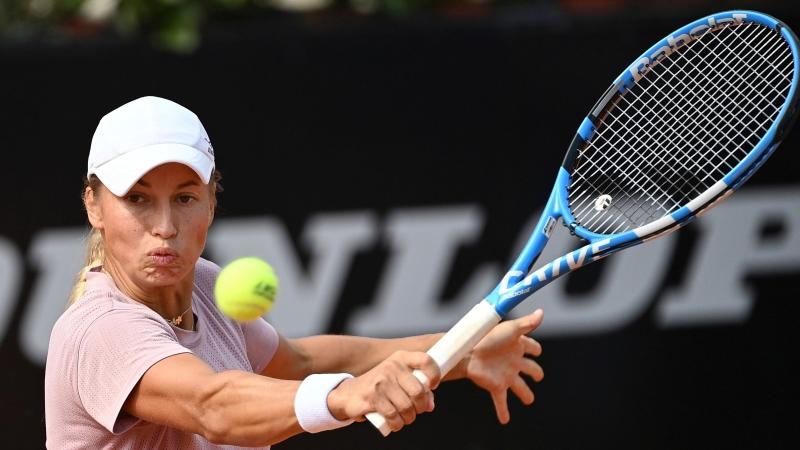 Yulia Putintseva returns the ball to Simona Halep during their quarterfinal match at the Italian Open tennis tournament, in Rome, Saturday, Sept. 19, 2020. (Alfredo Falcone/LaPresse via AP)
