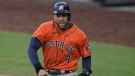 Houston Astros George Springer reacts after scoring on a single by Jose Altuve against the Tampa Bay Rays during the fifth inning in Game 6 of a baseball American League Championship Series, Friday, Oct. 16, 2020, in San Diego. (AP Photo/Gregory Bull)