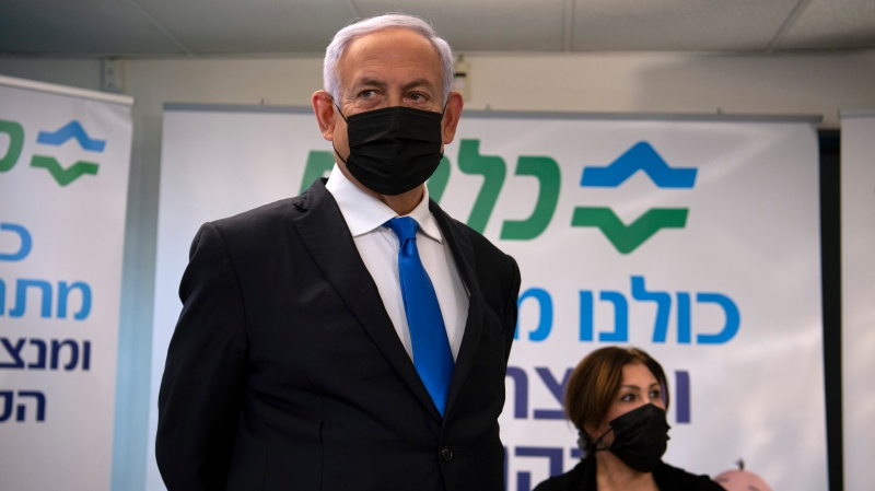 In this Jan. 13, 2021 file photo, Israeli Prime Minister Benjamin Netanyahu visits a coronavirus vaccination facility in the northern Arab city of Nazareth, Israel. (Gil Eliyahu/Pool via AP, File)
