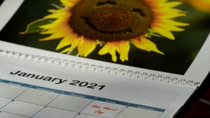 New Year's Day is seen on a 2021 calendar Friday, July 10, 2020, in Overland Park, Kan. (AP Photo/Charlie Riedel)