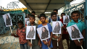 Village children hold placards featuring U.S. Vice President-elect Kamala Harris after participating in special prayers ahead of her inauguration, at a Hindu temple in Thulasendrapuram, the hometown of Harris' maternal grandfather, south of Chennai, Tamil Nadu state, India, Wednesday, Jan. 20, 2021. (AP Photo/Aijaz Rahi)