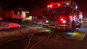 Fire crews outside of a home in the 8100 block of 46 Ave. N.W. during the response to a Wednesday morning house fire.